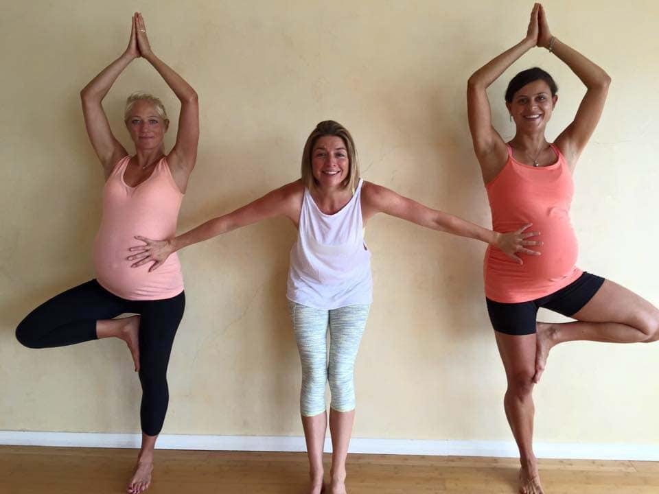 Nadine Richardson with two pregnant women doing She Births® prenatal yoga